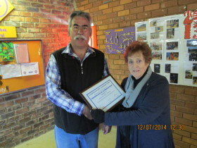 Chris ZS6LOG receiving his certificate from Pam ZS6APT