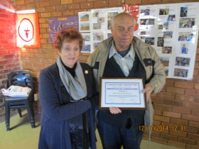 Johan ZS6CAQ receiving his certificate from Pam ZS6APT