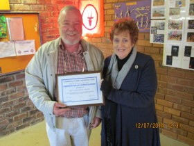Billy ZS6WPS receiving his certificate from Pam ZS6APT