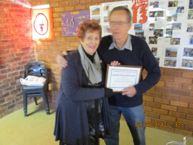 Dave ZS6AWW receiving his certificate from Pam ZS6APT