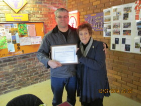 Daryl ZS6DLL receiving his certificate from Pam ZS6APT