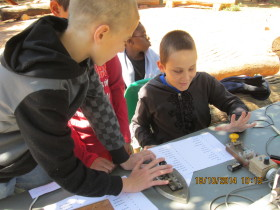 One of the Scouts sending Morse Code